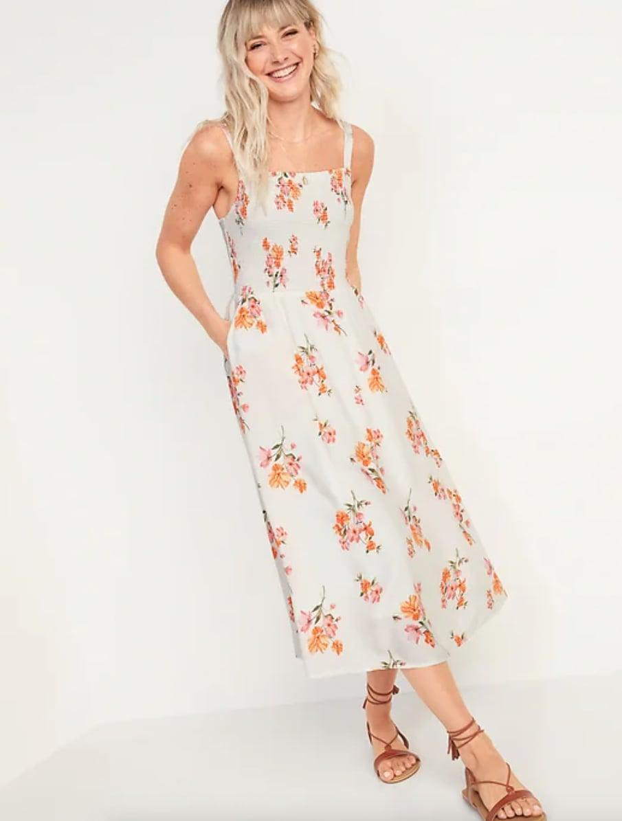<p>This <span>Old Navy Smocked Fit &amp; Flare Cami Midi Dress</span> ($35, originally $40) is such an easygoing piece for warm days. </p>