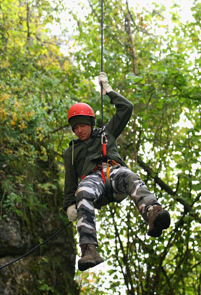 NUREMBERG, GERMANY - SEPTEMBER 26:  England batsman Eoin Morgan abseils down the rockface during an abseiling excercise at the England Cricket squad Pre Ashes Training Camp on September 26, 2010 near Nuremberg, Germany.  (Photo by Stu Forster/Getty Images)