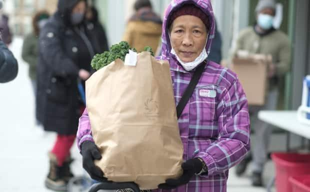 Trini Fillon, 70, lives alone on a senior's pension in Toronto's St. James Town neighbourhood. She stretches the fruits and vegetables she gets in her food bag to last two weeks.