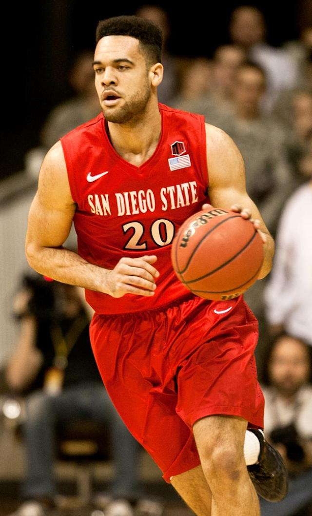 San Diego State forward JJ O'Brien (20) brings the ball down court during a mens NCAA basketball game against Wyoming on Tuesday, Feb. 11, 2014 at the Arena-Auditorium in Laramie, Wyo.(AP Photo/Jeremy Martin)