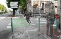 """As described in a story from the <a href=""""http://www.dailymail.co.uk/news/article-2219584/Ghosts-war-Artist-superimposes-World-War-II-photographs-modern-pictures-street-scenes.html"""" rel=""""nofollow noopener"""" target=""""_blank"""" data-ylk=""""slk:Daily Mail"""" class=""""link rapid-noclick-resp"""">Daily Mail</a>, Dutch historian Jo Teeuwisse discovered 300 negatives in a flea market and began to research the sites of the photos. This photo shows soldiers on Avenue de Paris in Cherbourg in 1944.<br><br>(<a href=""""http://www.flickr.com/photos/hab3045/collections/72157629378669812/"""" rel=""""nofollow noopener"""" target=""""_blank"""" data-ylk=""""slk:Courtesy of Jo Teeuwisse"""" class=""""link rapid-noclick-resp"""">Courtesy of Jo Teeuwisse</a>)"""