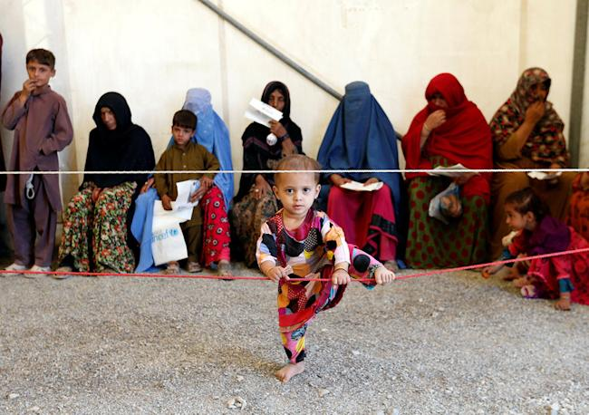Afghan women sit with their children after arriving at a United Nations High Commissioner for Refugees (UNHCR) registration centre in Kabul, Afghanistan September 27, 2016. Picture taken September 27, 2016. REUTERS/Mohammad Ismail