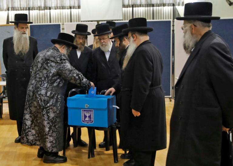 Security is a dominant theme in all Israeli elections but issues like the cost of living or exemptions from military service for ultra-Orthodox Jews also sway voters (AFP Photo/Menahem KAHANA)