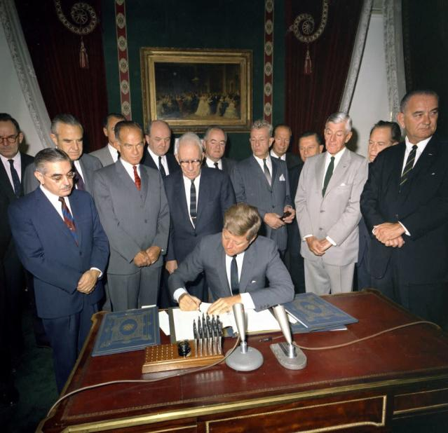 President John F. Kennedy signing the Nuclear Test Ban Treaty, with Vice President Lyndon B. Johnson and others, on Oct. 7, 1963. (Photo: Robert Knudsen/John F. Kennedy Presidential Library and Museum)