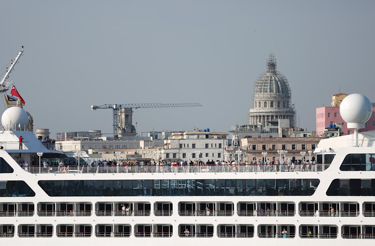 FILE PHOTO: People look at the city of Havana from the deck of U.S. Carnival cruise ship Adonia as it enters at the Havana bay, the first cruise liner to sail between the United States and Cuba since Cuba's 1959 revolution, Cuba, May 2, 2016. REUTERS/Alexandre Meneghini/File Photo                    GLOBAL BUSINESS WEEK AHEAD - SEARCH GLOBAL BUSINESS 27 MAR FOR ALL IMAGES