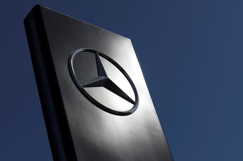 FILE PHOTO: A logo of Mercedes-Benz is seen outside a Mercedes-Benz car dealer, amid the coronavirus disease (COVID-19) outbreak in Brussels
