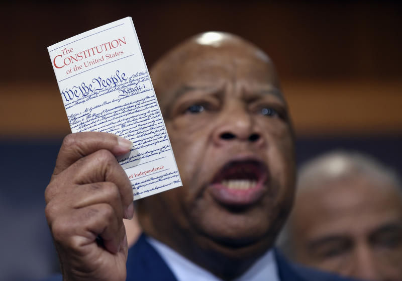 Rep. John Lewis, D-Ga., holds a copy of the Constitution as he talks about appointing another judge to the Supreme Court during a March 3, 2016, news conference on Capitol Hill in Washington. (Photo: Susan Walsh/AP)