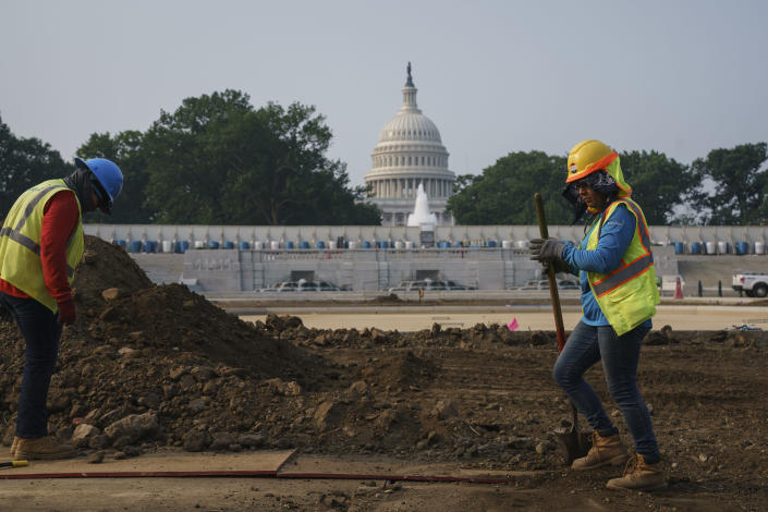 FILE - In this July 21, 2021, file photo workers repair a park near the Capitol in Washington. Senators working on the infrastructure plan hope to have a bill ready to be voted on next week. President Joe Biden has made passing the bipartisan plan a top priority, the first of his two-part $4 trillion proposal to rebuild, but a Senate test vote failed this week after Republicans said they needed more time to finish the package and review the details. (AP Photo/J. Scott Applewhite, File)