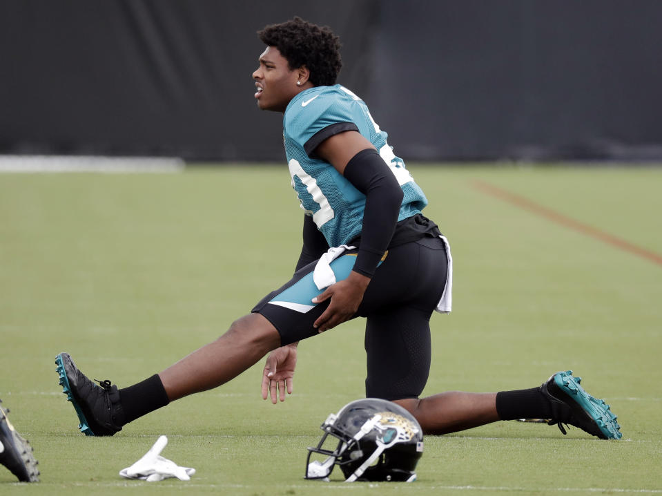Jacksonville Jaguars cornerback Jalen Ramsey stretches out during a practice at NFL football training camp, Tuesday, July 31, 2018, in Jacksonville, Fla. (AP Photo/John Raoux)
