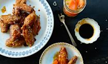 """Gochujang (Korean hot pepper paste) makes up the spicy backbone of these wings from <a href=""""http://www.amazon.com/Smoke-Pickles-Recipes-Stories-Southern/dp/1579654924"""" rel=""""nofollow noopener"""" target=""""_blank"""" data-ylk=""""slk:Smoke and Pickles"""" class=""""link rapid-noclick-resp"""">Smoke and Pickles</a> author Edward Lee. <a href=""""https://www.bonappetit.com/recipe/korean-fried-chicken-wings?mbid=synd_yahoo_rss"""" rel=""""nofollow noopener"""" target=""""_blank"""" data-ylk=""""slk:See recipe."""" class=""""link rapid-noclick-resp"""">See recipe.</a>"""
