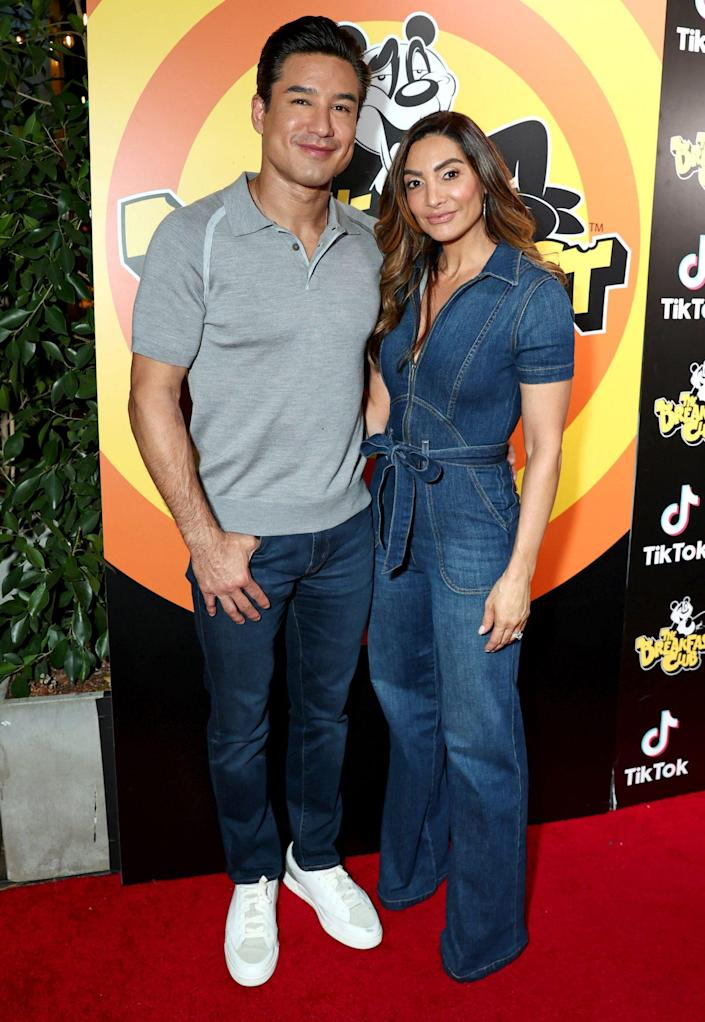 <p>Mario and Courtney Lopez don denim on Sept. 21 for the grand opening of The Breakfast Club in Hollywood. </p>