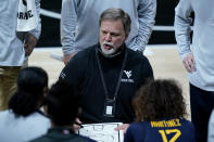 West Virginia head coach Mike Carey talks to his players during the first half of an of an NCAA college basketball game against Baylor in the final round of the Big 12 Conference tournament in Kansas City, Mo, Sunday, March 14, 2021. (AP Photo/Charlie Riedel)