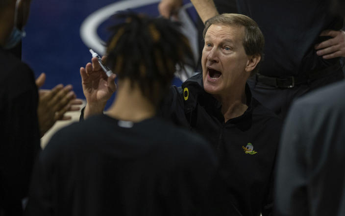 Oregon head coach Dana Altman talks with his players during a timeout in an NCAA college basketball game against Arizona, Saturday, Feb. 13, 2021, in Tucson, Ariz. (Josh Galemore/Arizona Daily Star via AP)