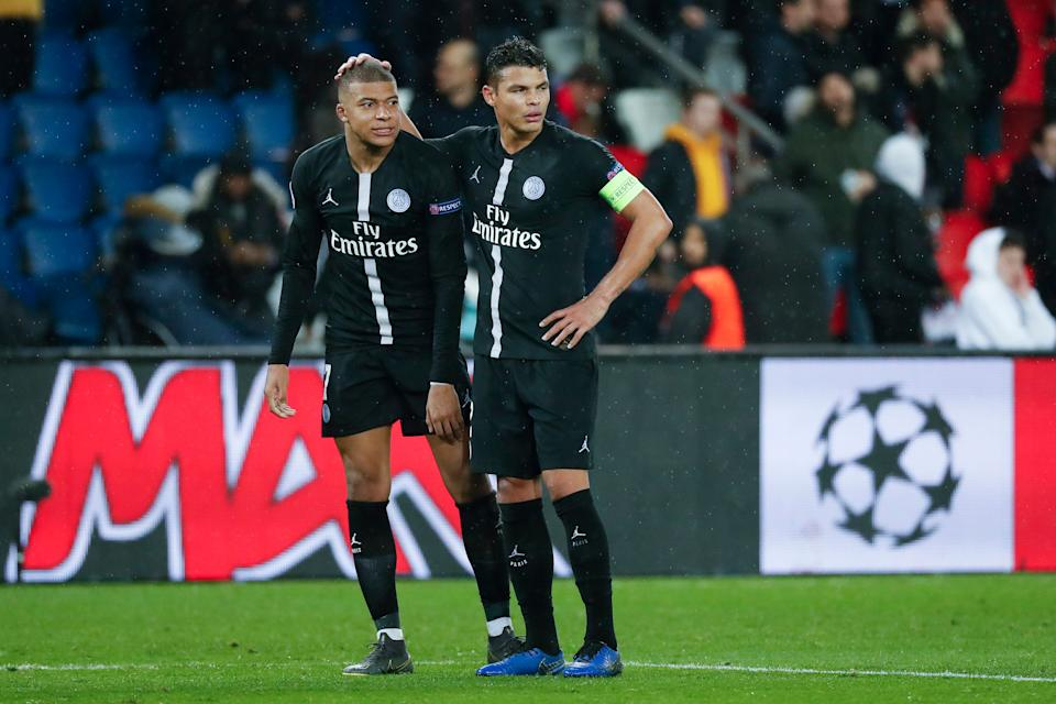 PARIS, FRANCE - MARCH 06: Kylian Mbappe #7 and Thiago Silva #2 of Paris Saint-Germain are upset after the loss of the UEFA Champions League Round of 16 Second Leg match between Paris Saint-Germain and Manchester United at Parc des Princes on March 6, 2019 in Paris, . (Photo by Catherine Steenkeste/Getty Images)