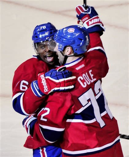 Montreal Canadiens' P.K. Subban, left, congratulates teammate Erik Cole for a goal against the Buffalo Sabres during second period NHL hockey action Monday, Nov. 14, 2011 in Montreal. (AP Photo/The Canadian Press, Paul Chiasson)