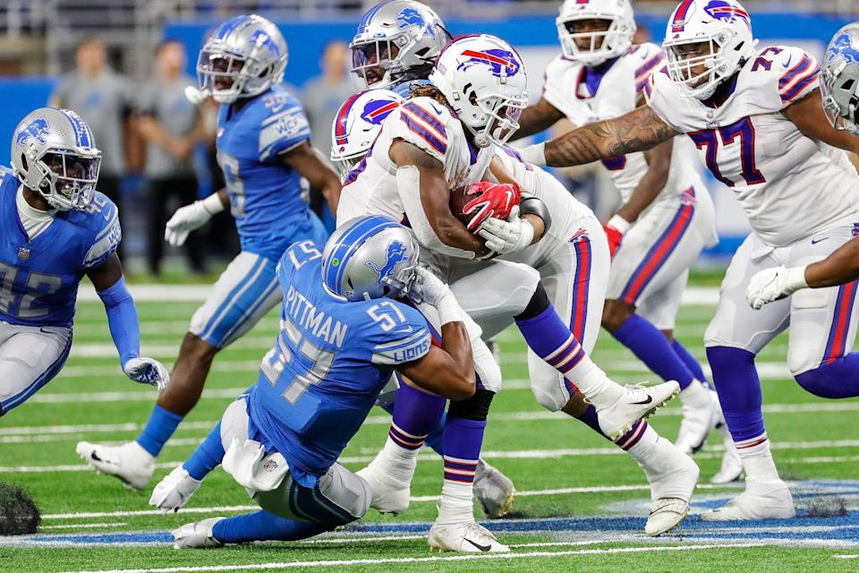 Detroit Lions linebacker Anthony Pittman (57) tackles Buffalo Bills running back Antonio Williams (28) during the second half of the preseason game at Ford Field in Detroit on Friday, Aug. 13, 2021.