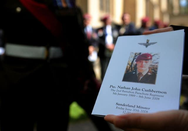 An order of service showing a picture of Private Nathan Cuthbertson during his funeral at Sunderland Minster