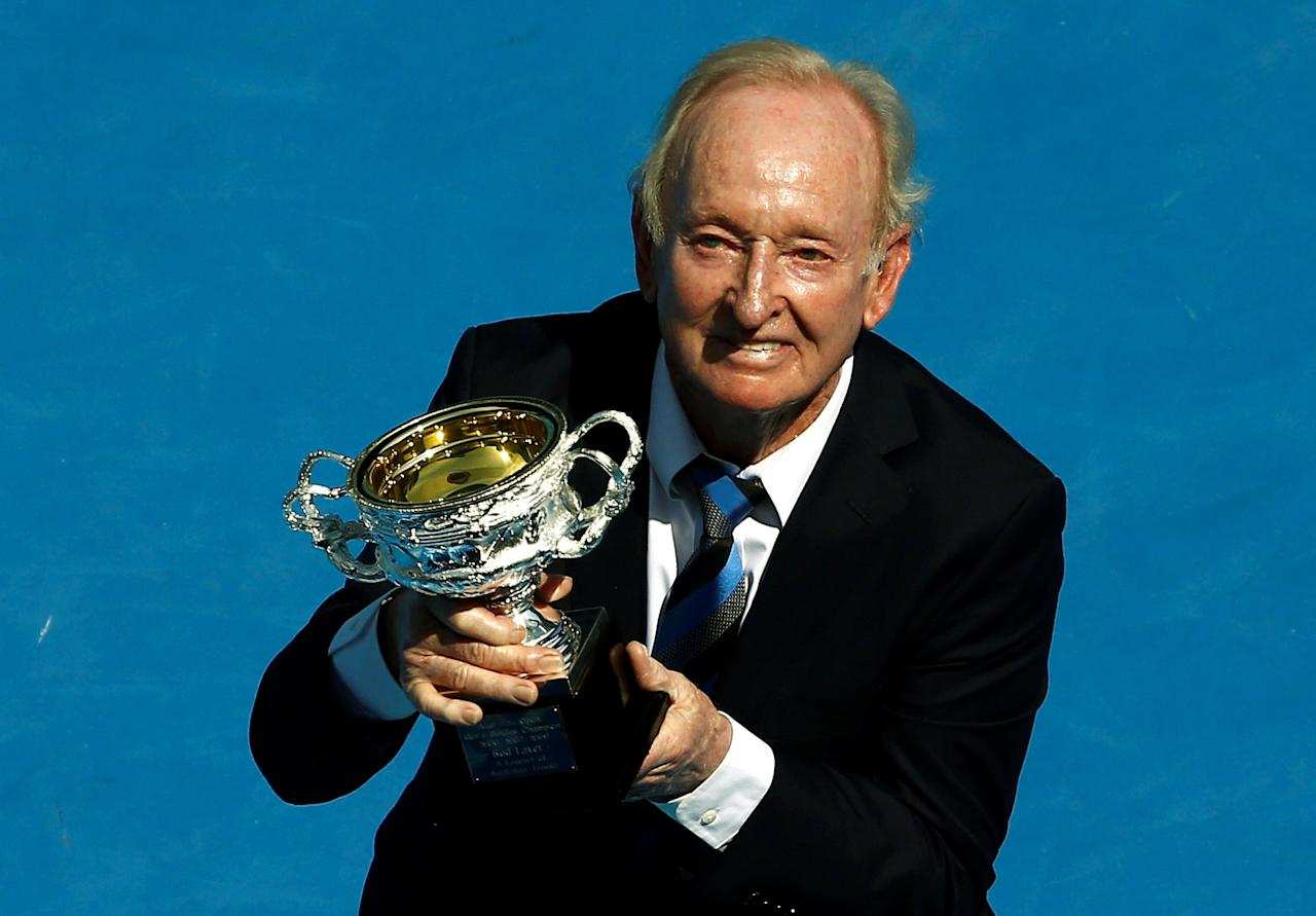 FILE PHOTO: Former Australian tennis player Rod Laver holds a trophy presented to him during a ceremony on Australia Day at the Rod Laver Arena at the Australian Open tennis tournament at Melbourne Park, Australia, January 26, 2016.  REUTERS/Jason Reed/File Photo