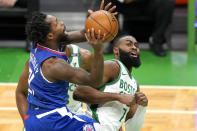 LA Clippers guard Patrick Beverley (21) drives to the hoop against Boston Celtics guard Jaylen Brown (7) in the first quarter of an NBA basketball game, Tuesday, March 2, 2021, in Boston. (AP Photo/Elise Amendola)