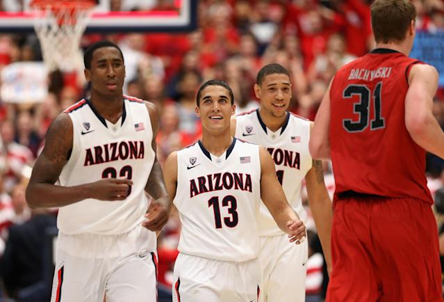 TUCSON, AZ - JANUARY 26: Nick Johnson #13 of the Arizona Wildcats walks off the court alongside Rondae Hollis-Jefferson #23 (L) and Brandon Ashley #21 (second from right) after defeating the Utah Utes in the college basketball game at McKale Center on January 26, 2014 in Tucson, Arizona. The Wildcats defeated the Utes 65-56. (Photo by Christian Petersen/Getty Images)