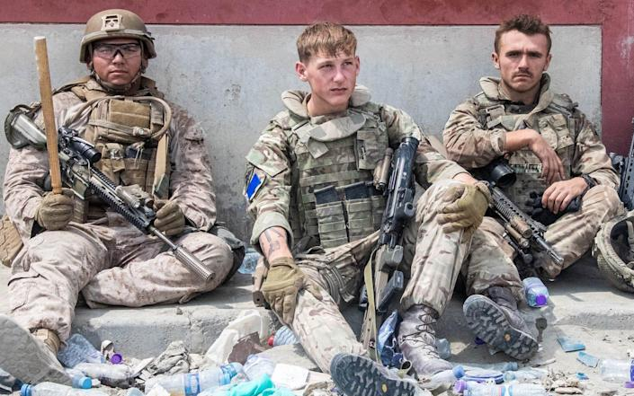 Soldiers deployed in Kabul take a break, as the number of Afghans seeking asylum continues to grow day by day - Crown Copyright