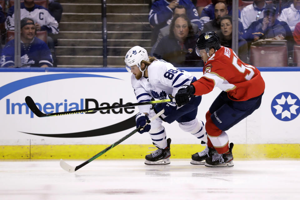 Toronto Maple Leafs right wing William Nylander (88) and Florida Panthers defenseman MacKenzie Weegar (52) vie for the puck during the first period of an NHL hockey game Thursday, Feb. 27, 2020, in Sunrise, Fla. (AP Photo/Wilfredo Lee)