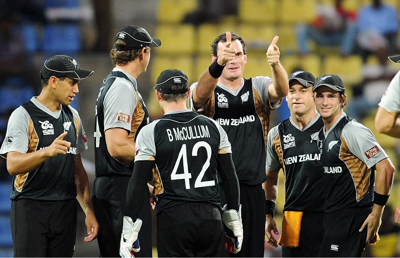 New Zealand cricketer Kyle Mills (C) celebrates the wicket of Bangladesh batsman Shakib Al Hasan (unseen) with teammates during the ICC Twenty20 Cricket World Cup match between Bangladesh and New Zealand at The Pallekele International Cricket Stadium in Pallekele  on September 21, 2012. AFP PHOTO/ Prakash SINGH