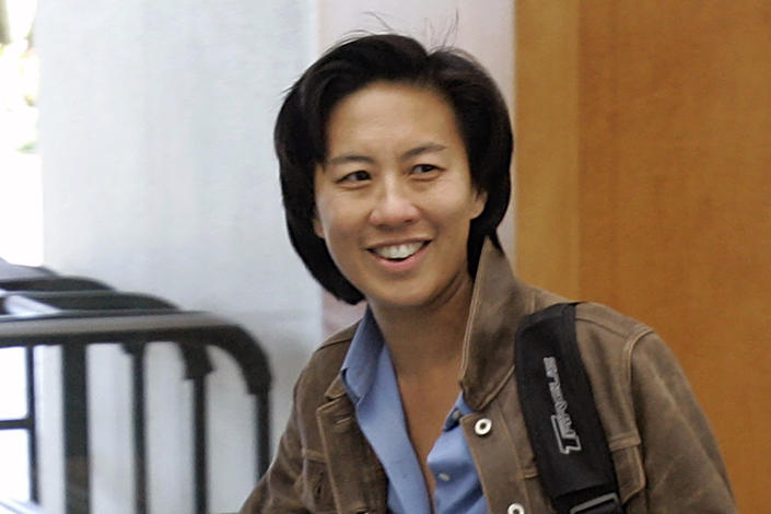 FILE - In this Nov. 5, 2007, file photo, then-Los Angeles Dodgers assistant general manager Kim Ng walks through the hotel lobby during the first day of the Major League Baseball annual general managers meetings in Orlando, Fla. Ng became the highest-ranking woman in baseball operations in the major leagues when the Miami Marlins hired her as general manager in 2020. (AP Photo/John Raoux, File)