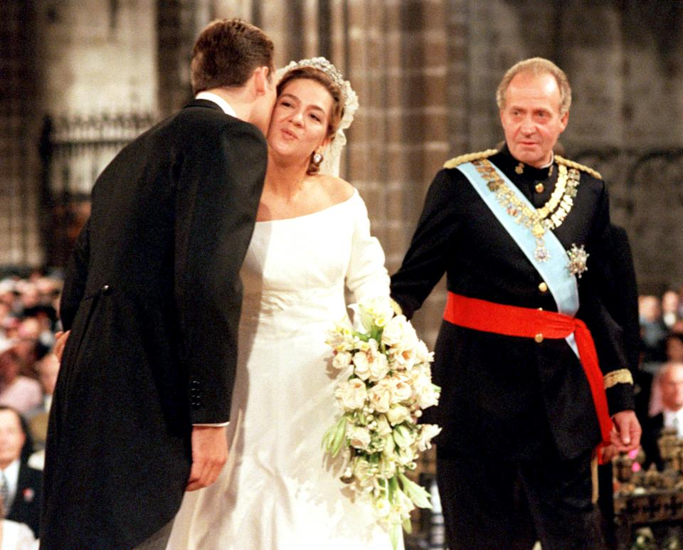 Spain's King Juan Carlos (R) watches as his daughter, Princess Cristina, is kissed by Inaki Urdangarin during her wedding, October 4. Princess Cristina married Olympic handball star Urdangarin inside a majestic Gothic cathedral filled with royalty from around the world.