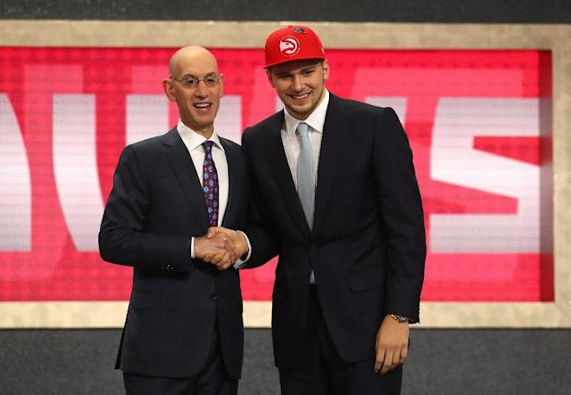 Luka Doncic (R) is congratulated by NBA Commissioner Adam Silver after being drafted third overall by the Atlanta Hawks during the 2018 NBA Draft, at the Barclays Center in New York, on June 21 (AFP Photo/Mike Stobe)