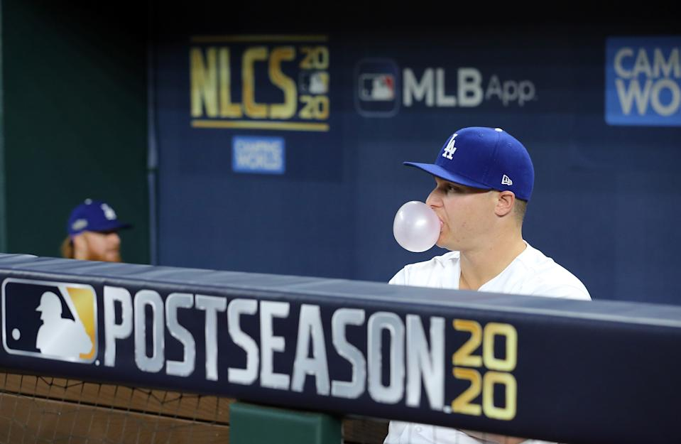 ARLINGTON, TX - OCTOBER 12: Joc Pederson #31 of the Los Angeles Dodgers blows a bubble in the dugout during Game 1 of the NLCS between the Atlanta Braves and the Los Angeles Dodgers at Globe Life Field on Monday, October 12, 2020 in Arlington, Texas. (Photo by Kelly Gavin/MLB Photos via Getty Images)
