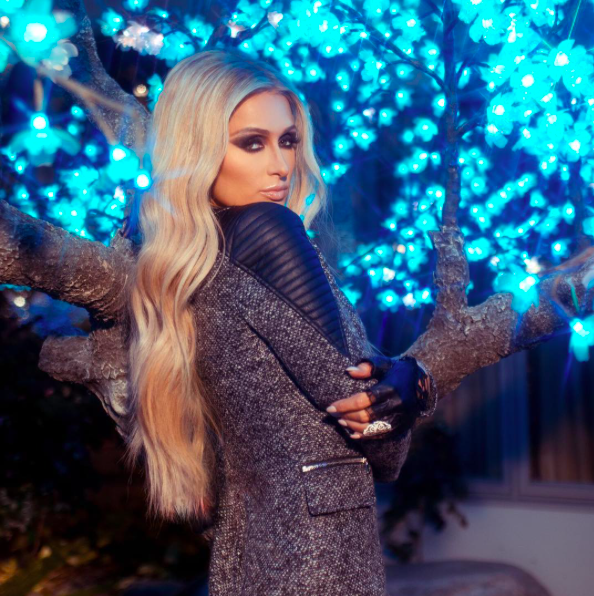 <p>The socialite may look cold, but her beauty look is hot! Hilton works the camera wearing long, loose waves, a smoldering cat-eye, sculpted cheekbones, and nude lips. (Photo: Paris Hilton via Instagram) </p>