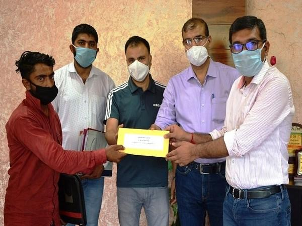 District Commissioner of Poonch Rahul Yadav handed over the appointment orders to the family members 3 died in border shelling. (Photo/ANI)