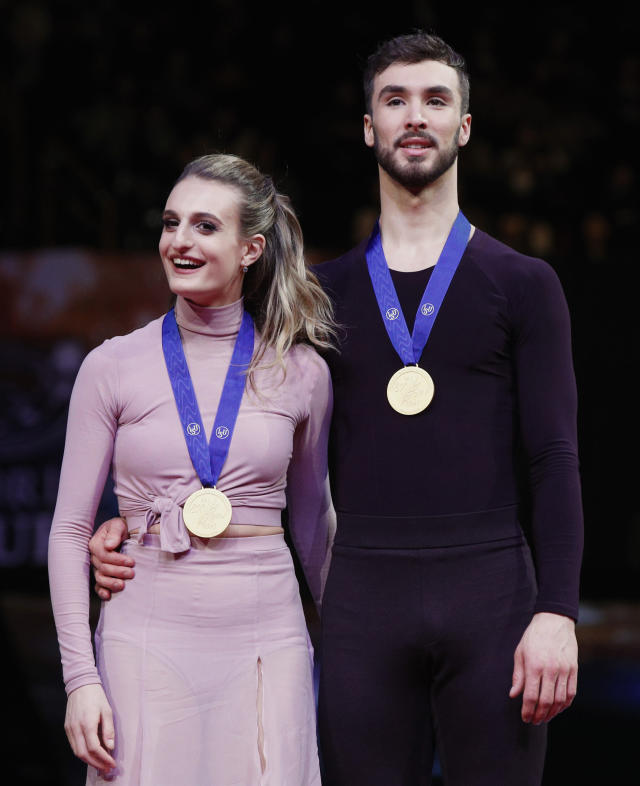 Gabriella Papadakis and Guillaume Cizeron of France stand with their medals after winning the gold for the ice dance free dance during the ISU World Figure Skating Championships at Saitama Super Arena in Saitama, north of Tokyo, Saturday, March 23, 2019. (AP Photo/Andy Wong)
