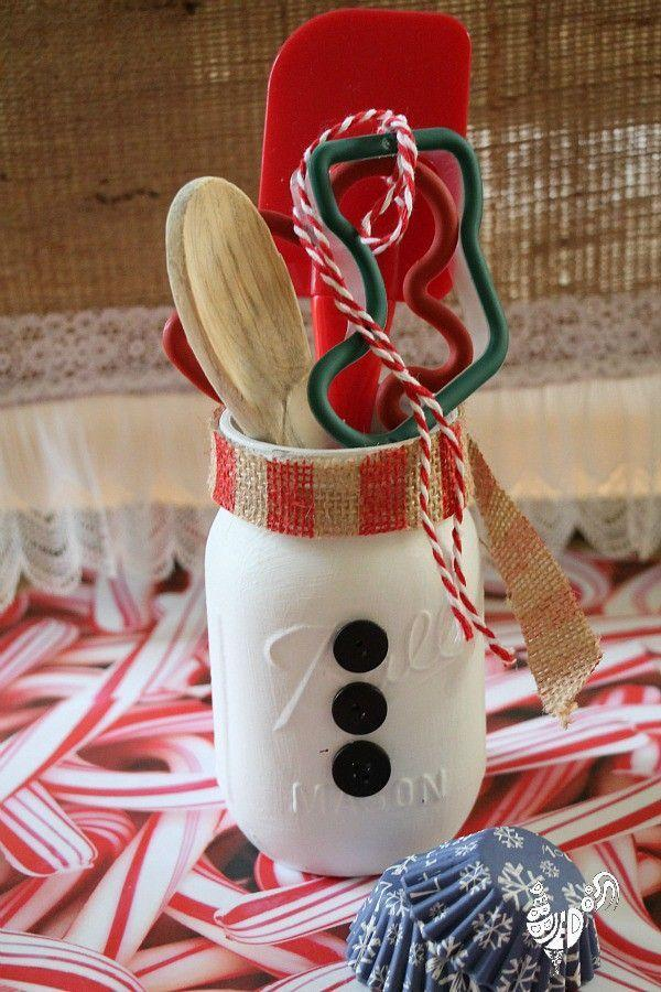 """<p>Stuff this sweet little snowman Mason jar with spatulas, spoons and Yuletide-themed cookie cutters and you've got a thoughtful hostess or teacher gift.</p><p><strong>Get the tutorial at <a href=""""https://www.debbie-debbiedoos.com/mason-jar-themed-christmas-gift-ideas/"""" rel=""""nofollow noopener"""" target=""""_blank"""" data-ylk=""""slk:Debbiedoo's"""" class=""""link rapid-noclick-resp"""">Debbiedoo's</a>.</strong></p><p><a class=""""link rapid-noclick-resp"""" href=""""https://www.amazon.com/s?k=christmas+red+cookie+cutter&ref=nb_sb_noss_2&tag=syn-yahoo-20&ascsubtag=%5Bartid%7C10050.g.2132%5Bsrc%7Cyahoo-us"""" rel=""""nofollow noopener"""" target=""""_blank"""" data-ylk=""""slk:SHOP COOKIE CUTTERS"""">SHOP COOKIE CUTTERS</a></p>"""