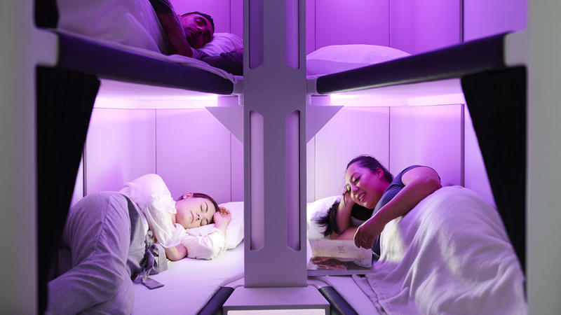 Flyers lie down in economy Skynest bed on Air New Zealand Flight