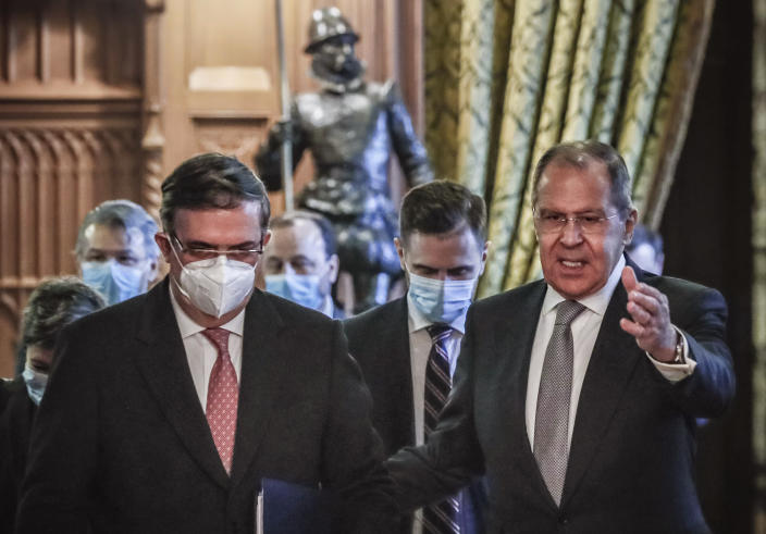 Russian Foreign Minister Sergei Lavrov, right, and Mexican Foreign Minister Marcelo Ebrard enter a hall during their meeting in Moscow, Russia, Wednesday, April 28, 2021. Mexican Foreign Minister Marcelo Ebrard is on a working visit to Moscow. (Yuri Kochetkov/Pool Photo via AP)