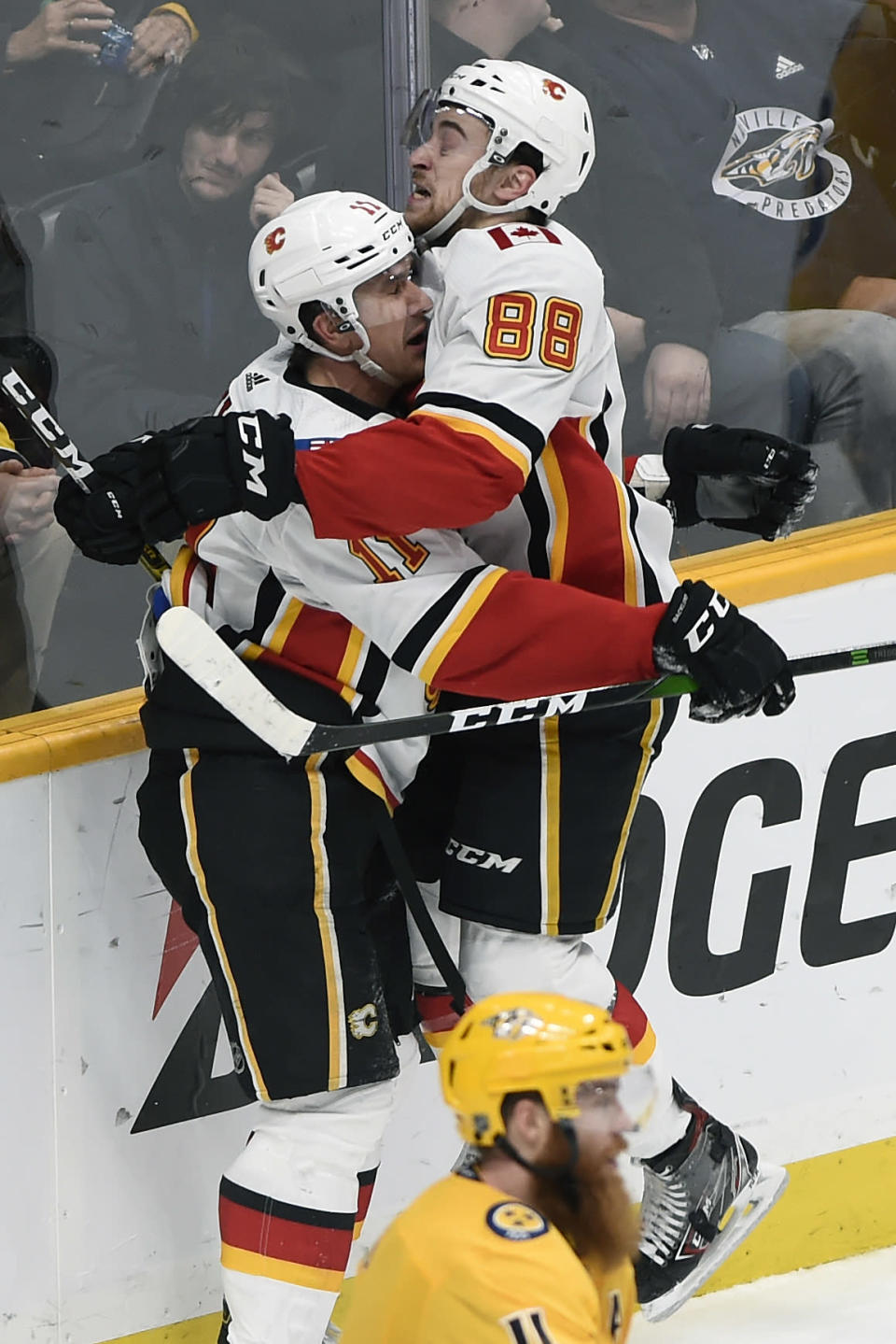 Calgary Flames left wing Andrew Mangiapane (88) celebrates with center Mikael Backlund (11), of Sweden, after scoring the go-ahead goal in the third period of an NHL hockey game against the Nashville Predators, Thursday, Feb. 27, 2020, in Nashville, Tenn. (AP Photo/Mark Zaleski)