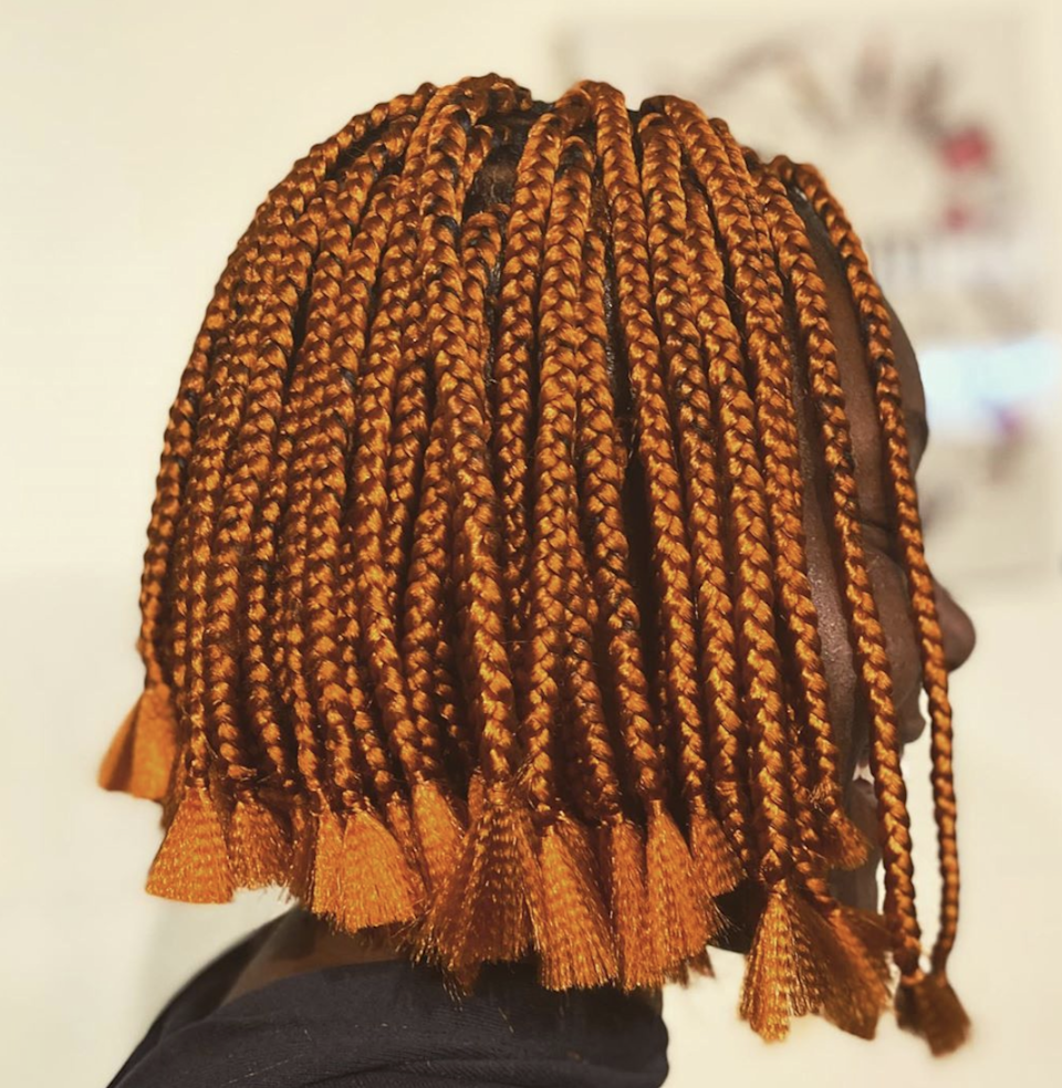 Infuse a little (or a lot) of color into your look and pick up some orange hair for your braids. Have them styled into a bob and let the ends fan out. Obsessed.