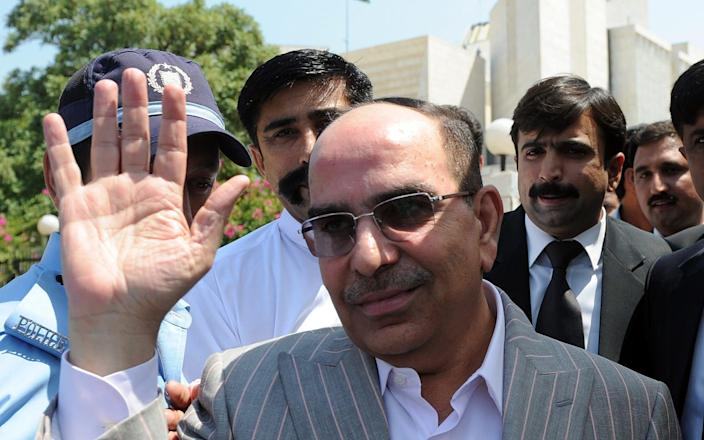 Real estate tycoon Malik Riaz waves as he leaves the Supreme Court on his contempt of court case in Islamabad June 21, 2012. Pakistan's top court stopped short of indicting the son of its chief justice and a billionaire businessman, kicking into the long grass corruption allegations that damage its credibility. In a case that has captivated the Pakistani political and media elite, Supreme Court judges asked the attorney general to investigate Arsalan Iftikhar Chaudhry, - AFP