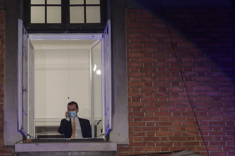 Romanian PM and leader of PNL, Ludovic Orban, speaks on the phone before first exit polls