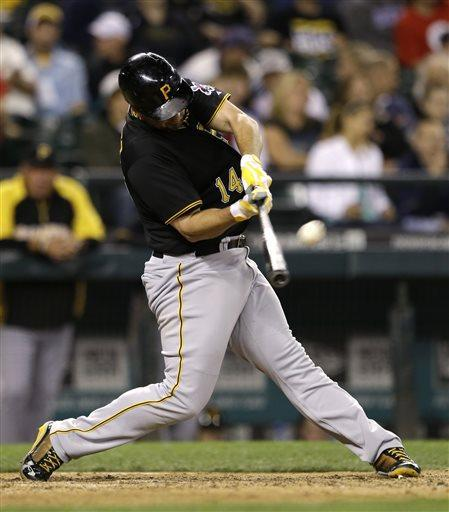 Pittsburgh Pirates' Gaby Sanchez homers against the Seattle Mariners in the ninth inning of a baseball game Tuesday, June 25, 2013, in Seattle. (AP Photo/Elaine Thompson)