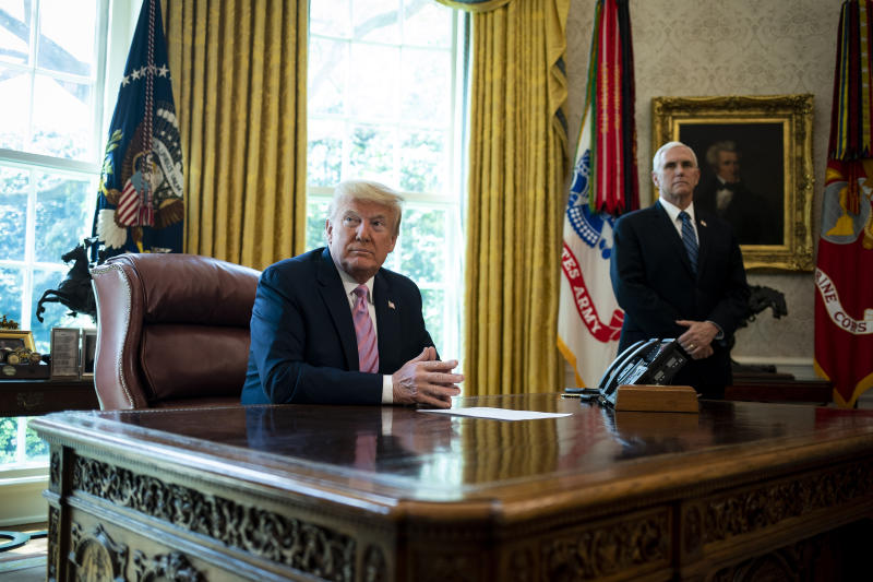 President Donald Trump and Vice President Mike Pence, during an Easter blessing in the Oval Office of the White House in Washington, Friday, April 10, 2020. (Al Drago/The New York Times)