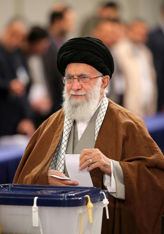 Iran's Supreme Leader Ayatollah Ali Khamenei casts a ballot in February 2020 parliamentary elections in a photo distributed by his office (AFP Photo/-)