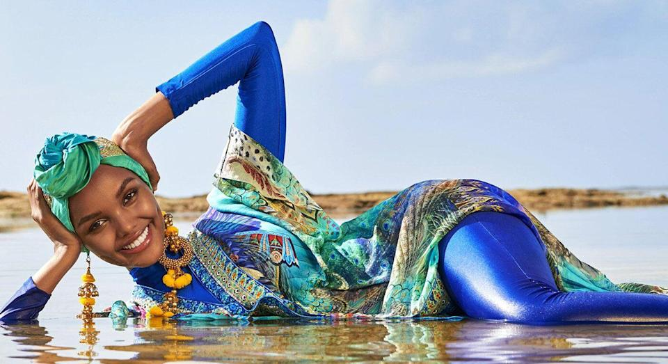 Halima Aden wears a burkini and hijab in the latest issue of Sports Illustrated. [Photo: Getty]