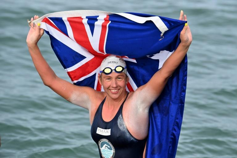 Australian marathon swimmer Chloe McCardel celebrates following her 10-hour swim across the English Channel for a world record-breaking 44th time (AFP/Ben STANSALL)