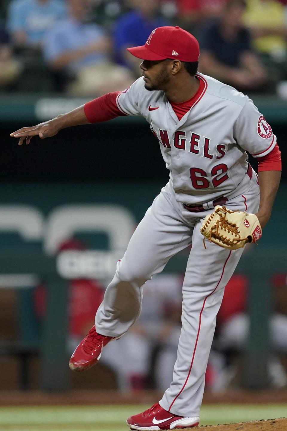 Los Angeles Angels relief pitcher Oliver Ortega follows through on his delivery to the Texas Rangers in the third inning of a baseball game in Arlington, Texas, Tuesday, Sept. 28, 2021. (AP Photo/Tony Gutierrez)