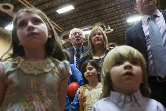 <p>Democratic presidential candidate Sen. Bernie Sanders, center left, watches the results with his wife, Jane, center right, during a primary-night watch party at Concord High School on Feb. 9, 2016, in Concord, N.H. (John Minchillo/AP)</p>