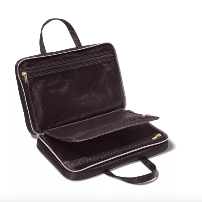 """<p><strong>Sonia Kashuk</strong></p><p>target.com</p><p><strong>$19.99</strong></p><p><a href=""""https://www.target.com/p/sonia-kashuk-8482-weekender-makeup-bag-black/-/A-52702304"""" rel=""""nofollow noopener"""" target=""""_blank"""" data-ylk=""""slk:Shop Now"""" class=""""link rapid-noclick-resp"""">Shop Now</a></p><p>At $20 and the size of a briefcase, we're trying to think of a reason why anyone <em>wouldn't</em> need this bag in their collection.</p>"""