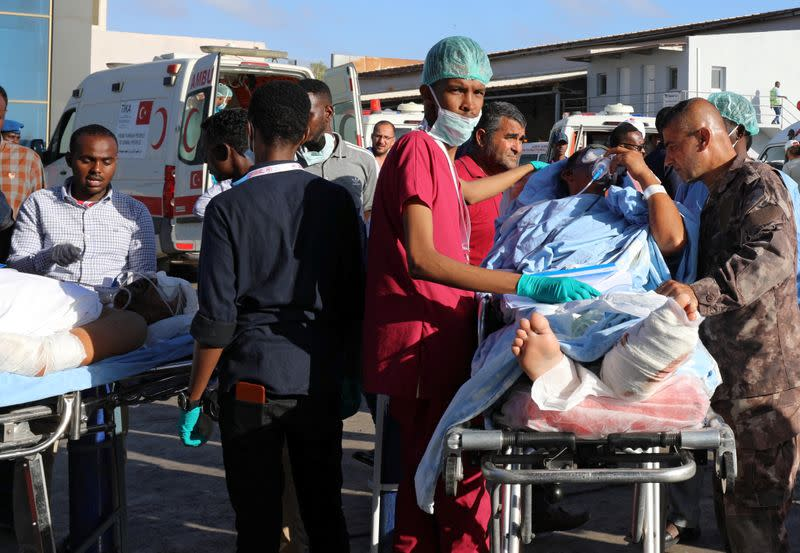 Paramedics assist Turkish workers injured in an explosion in Afgoye town, before they board a Turkish military cargo plane at the Aden Abdulle International Airport in Mogadishu